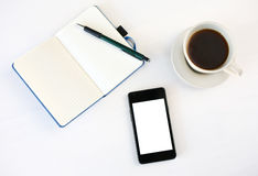 Smartphone, coffee and planning book Stock Image