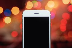 Smartphone on the colorful bokeh background.  stock photo