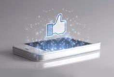 Smartphone com 3d Facebook gosta do ícone Fotos de Stock Royalty Free