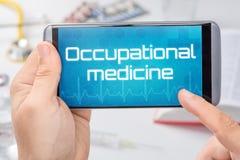 Smartphone com a medicina ocupacional do texto foto de stock royalty free