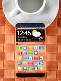 Smartphone com uma exposição transparente Fotos de Stock Royalty Free
