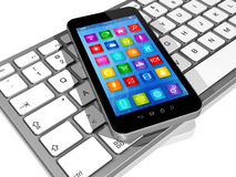 Smartphone on Computer Keyboard Royalty Free Stock Photography