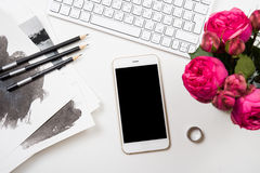 Smartphone, computer keyboard and fesh pink flowers on white tab Stock Photography