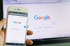 Google search. A smartphone and computer running google search Royalty Free Stock Photography