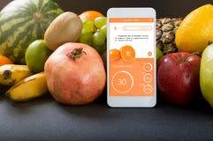 Smartphone con il app che mostra l'indice glycemic Fotografia Stock Libera da Diritti