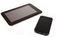Smartphone con la compressa Fotografia Stock