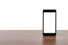 Smartphone con la pantalla en blanco Imágenes de archivo libres de regalías
