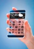 Smartphone con la pantalla transparente en manos humanas. foto de archivo libre de regalías