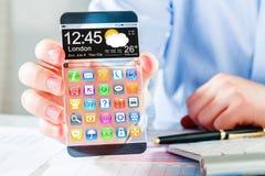 Smartphone con la pantalla transparente en manos humanas Imagen de archivo