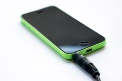 Smartphone con la presa delle cuffie Fotografia Stock
