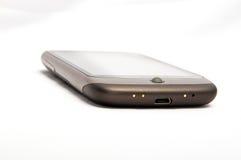 Smartphone con la sfera rotante Fotografie Stock Libere da Diritti