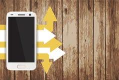 Smartphone con las hojas de papel Foto de archivo libre de regalías