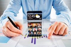 Smartphone con lo schermo trasparente in mani umane Fotografia Stock