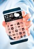 Smartphone con lo schermo trasparente in mani umane Fotografie Stock