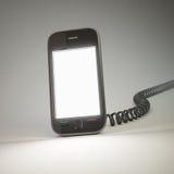 Smartphone con un telefono dell'annata Immagine Stock