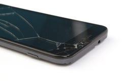 Smartphone con uno schermo di visualizzazione rotto su bianco Fotografia Stock Libera da Diritti