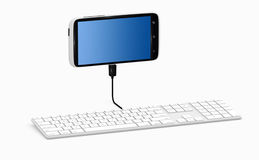 Smartphone connected to keyboard. Royalty Free Stock Photos