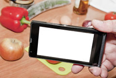 Smartphone and cooking Royalty Free Stock Photography