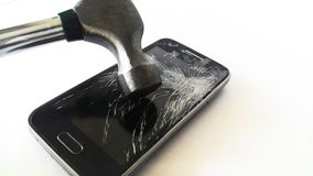 Smartphone crashed with a hammer royalty free stock photo