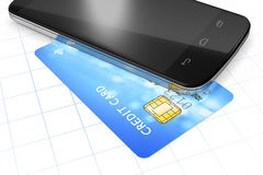 Smartphone and a credit card for mobile payment Stock Photos