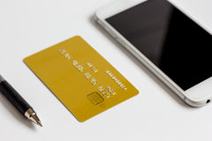Smartphone and credit card on white background online shopping Stock Image