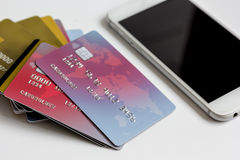 Smartphone and credit card on white background online shopping Royalty Free Stock Photos