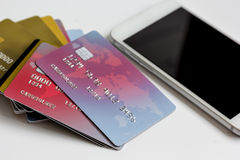 Smartphone and credit card on white background online shopping Stock Photo
