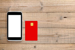 Smartphone and credit card on wood Stock Photography