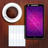 Smartphone, cup of coffee, notebook sheet Stock Image