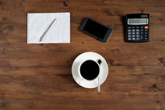 Smartphone, cup of coffee and office supplies Stock Photo