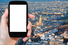 Smartphone with cut out screen and Paris cityscape Stock Image