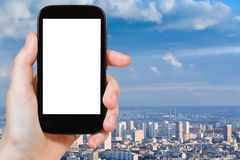 Smartphone with cut out screen and Paris panorama Royalty Free Stock Photos