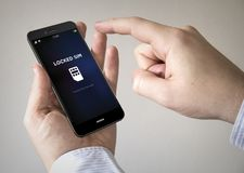 smartphone d'écran tactile avec le sim verrouillé sur l'écran Image libre de droits