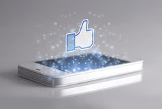 Smartphone with 3d Facebook like icon Royalty Free Stock Photos