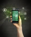 Smartphone da terra arrendada da mão Fotos de Stock Royalty Free