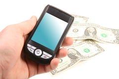 Smartphone de la explotación agrícola de la mano foto de archivo libre de regalías