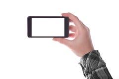 Smartphone de la explotación agrícola de la mano Fotos de archivo libres de regalías