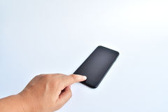 smartphone de noir de contact de main sur le fond blanc Photos stock