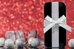 Smartphone and decorations for Christmas Stock Photos