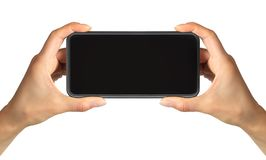 Smartphone del nero di rappresentazione della mano delle donne, concetto di presa foto o del selfie immagini stock libere da diritti