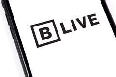 Smartphone del primer con el logotipo VIVO de BitTorrent foto de archivo