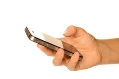 Smartphone della holding fotografia stock