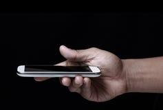 Smartphone della holding della mano Fotografia Stock