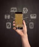 Smartphone della holding della mano Immagini Stock Libere da Diritti
