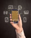 Smartphone della holding della mano Immagine Stock