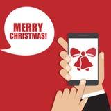 Smartphone della tenuta della mano con l'icona delle campane di Natale Illustrazione di vettore illustrazione vettoriale