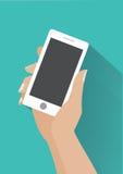Smartphone della tenuta della mano con lo schermo in bianco Fotografia Stock Libera da Diritti