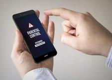Smartphone dello schermo attivabile al tatto con controllo paterno sullo schermo Fotografia Stock Libera da Diritti
