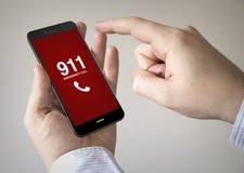 Smartphone dello schermo attivabile al tatto con la chiamata d'emergenza sullo schermo Fotografia Stock