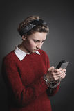 Smartphone dependency. Teenage girl with obsessed eyes Royalty Free Stock Photo